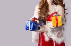 Beautiful asia woman model in Santa Claus clothes. In studio Royalty Free Stock Image
