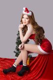 Beautiful asia woman model in Santa Claus clothes Royalty Free Stock Images