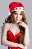 Beautiful asia woman model in Santa Claus clothes Royalty Free Stock Image