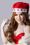 Beautiful asia woman model in Santa Claus clothes Royalty Free Stock Photography
