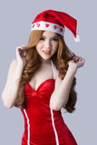 Beautiful asia woman model in Santa Claus clothes Stock Photos