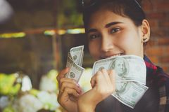 People`s hands holding US dollars banknotes with happy.