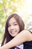 Beautiful asia woman smile. With warm light flare effect on top from the sun Royalty Free Stock Images