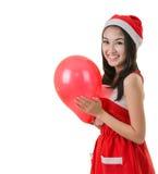 Beautiful Asia woman wear Santa Clause costume, christmas girl h Stock Image