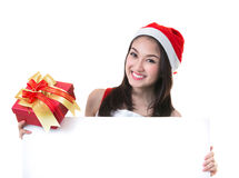 Beautiful Asia woman wear Santa Clause costume, christmas girl h Royalty Free Stock Images
