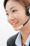 Beautiful asia young business woman with headset Stock Image