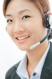 Beautiful asia young business woman with headset Royalty Free Stock Image