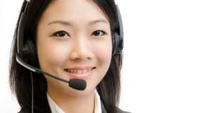 Beautiful asia young business woman with headset. Isolated on white background Royalty Free Stock Photo