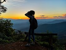 Beautiful Asia Young Woman Traveler Hiking with Backpack a Mountain Nature Background. Asian Female Traveller Relaxing Alone. royalty free stock images