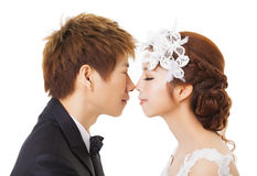 Beautiful asian bride and groom. Isolated Stock Photo