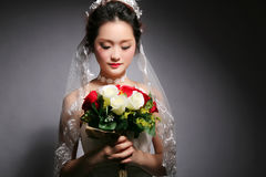 Beautiful asian bride. Isolated on gray background royalty free stock images