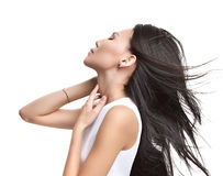 Beautiful asian brunette girl with healthy long hair isolated Stock Image