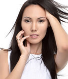 Beautiful asian brunette girl with healthy long hair. Isolated on a white background. Beauty Brunette Woman Royalty Free Stock Image