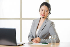 Beautiful asian business customer service woman smiling with a h Stock Photos
