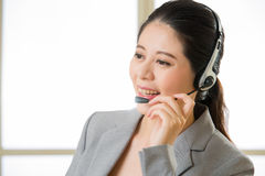 Beautiful asian business customer service woman smiling Stock Photography