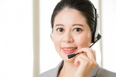Beautiful asian business customer service woman smiling Royalty Free Stock Image