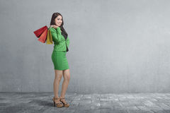 Beautiful asian business female standing with shopping bag Royalty Free Stock Images