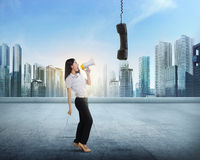 Beautiful asian business woman with bullhorn screaming to receiv Royalty Free Stock Images