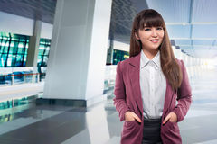 Beautiful asian business woman with hand on the pocket Royalty Free Stock Photos