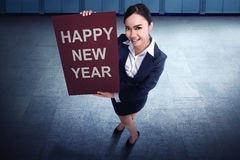 Beautiful asian business woman holding Happy New Year`s greeting Royalty Free Stock Images
