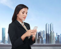 Beautiful asian business woman holding smartphone Royalty Free Stock Photography