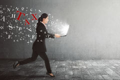 Beautiful asian business woman running with taxes from her lapto Stock Photo