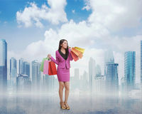 Beautiful asian business woman with shopping bags Stock Images