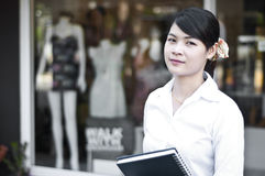 Beautiful Asian business woman in shopping mall. Stock Image