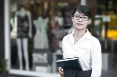 Beautiful Asian business woman in shopping mall. Stock Images