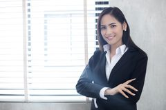 Beautiful Asian business women are smiling and working happy on Royalty Free Stock Photo