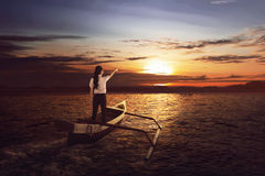 Beautiful asian business woman standing and pointing to the sun Stock Images