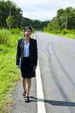 Beautiful Asian business woman walking. Stock Photos