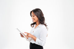 Beautiful asian businesswoman using tablet computer Royalty Free Stock Photos