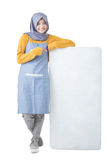 Beautiful Asian cafe owner holding blank white board Royalty Free Stock Photo