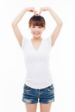 Beautiful Asian casual woman show heart shape. Royalty Free Stock Images