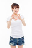 Beautiful Asian casual woman show heart shape. Royalty Free Stock Image