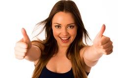Beautiful asian caucasian woman gesturing success showing thumb Royalty Free Stock Photo