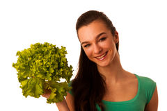 Beautiful asian caucasian woman holding a green salad in her han Royalty Free Stock Photos