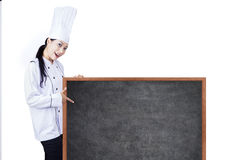 Beautiful chef show blank board Royalty Free Stock Photo