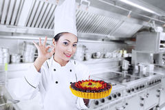Beautiful chef cook delicious cake Stock Images