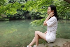A happy free smile peace balance meditation beauty girl Asian Chinese travel hiking smell maple do yoga by lake bag hangzhou xihu Royalty Free Stock Photos