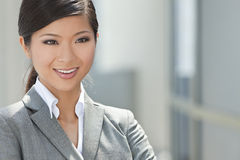 Beautiful Asian Chinese Woman or Businesswoman. Outdoor portrait of a beautiful young Asian Chinese woman or businesswoman in smart business suit stock photo