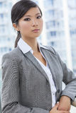Beautiful Asian Chinese Woman or Businesswoman. Outdoor portrait of a beautiful young Asian Chinese woman or businesswoman in smart business suit Stock Photos