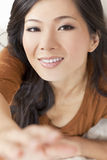 Beautiful Asian Chinese Woman Reaching To Camera Royalty Free Stock Image