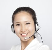 Beautiful asian Customer Representative Royalty Free Stock Photo