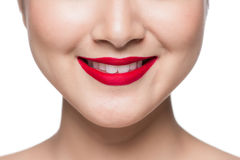 Beautiful asian face with red lips over white. Stock Image