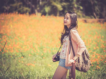 Beautiful Asian female backpacker with camera Royalty Free Stock Photos