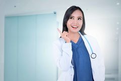 Beautiful asian female doctor in white coat and stethoscope with Royalty Free Stock Photography