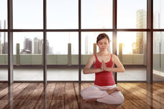 Beautiful asian female doing meditation in yoga pose. On the wooden floor royalty free stock photos