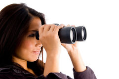 Beautiful  asian female looking through binocular Royalty Free Stock Photos
